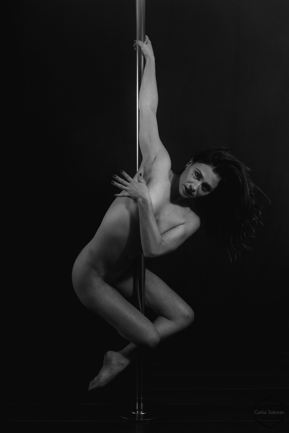 Asian naked pole dancer