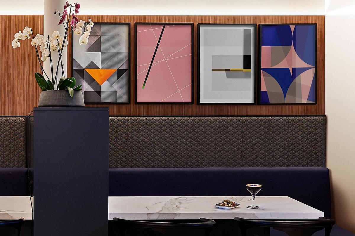 Artworks in Paris. Bar seating wall art. Crowne Plaza Paris Republique