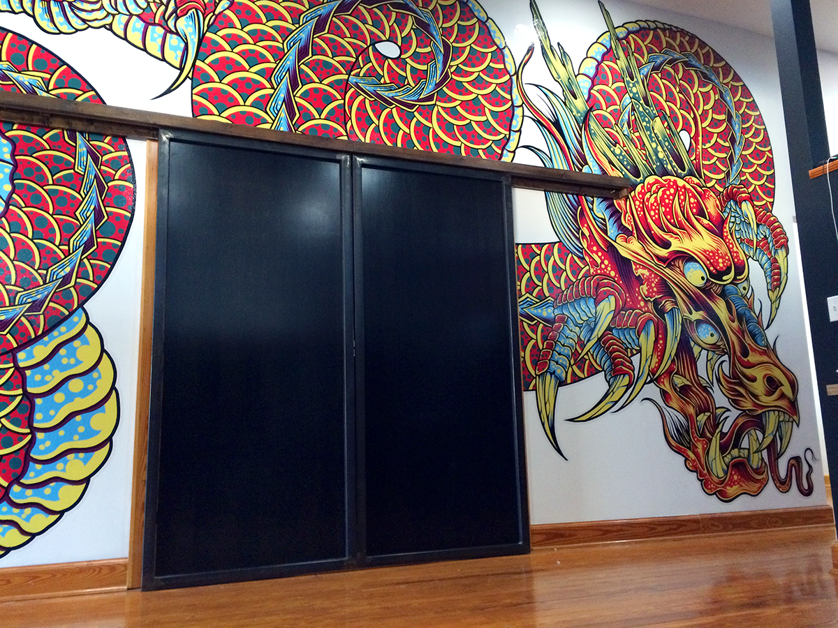 space dragon studio wall mural installation on behance
