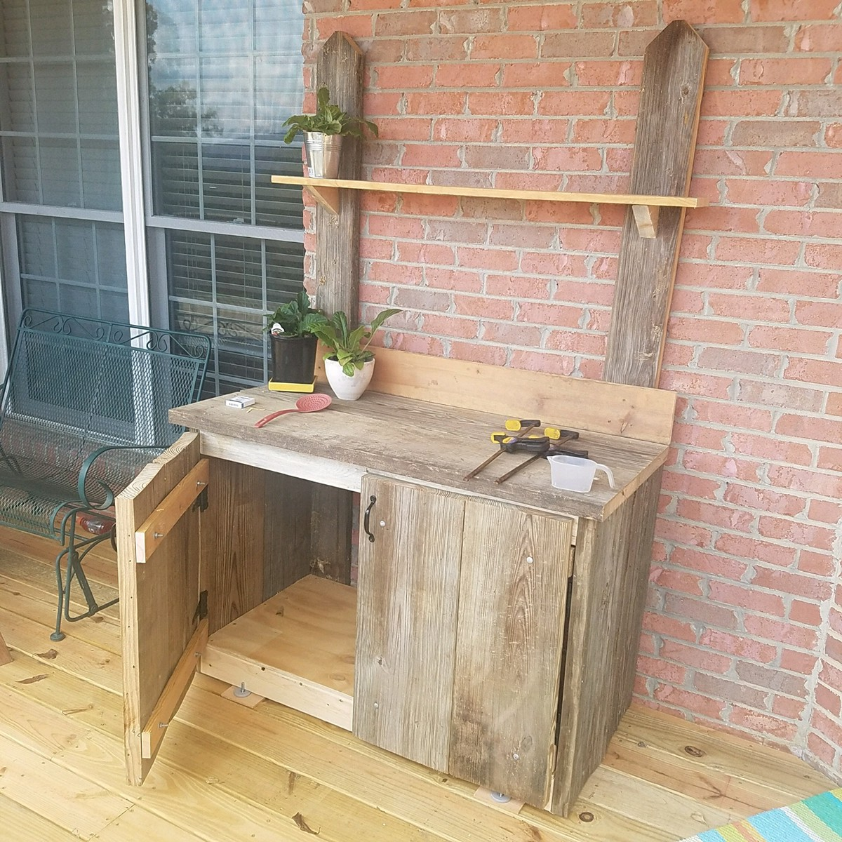 Custom Backyard Garden Tool Bench Constructed With Salvaged Planks