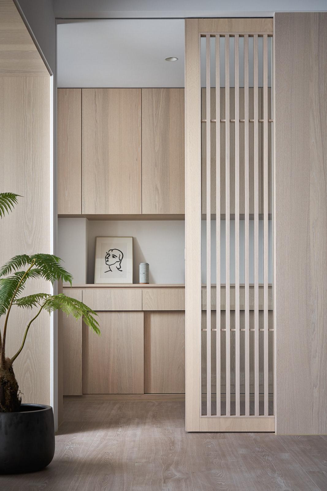 Image may contain: houseplant, door and floor