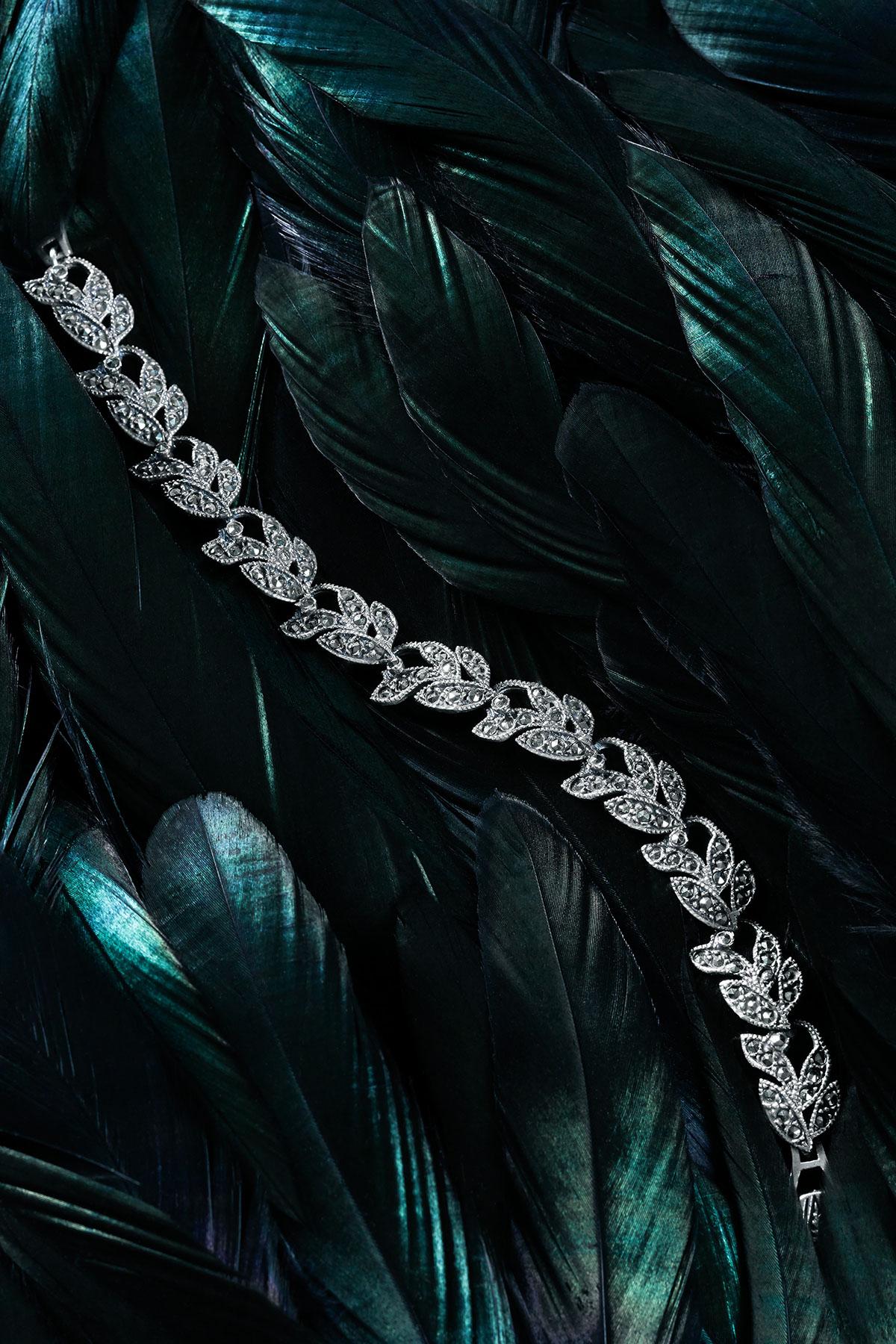 jewellery photography still life fine art Jewellery design blue green feathers