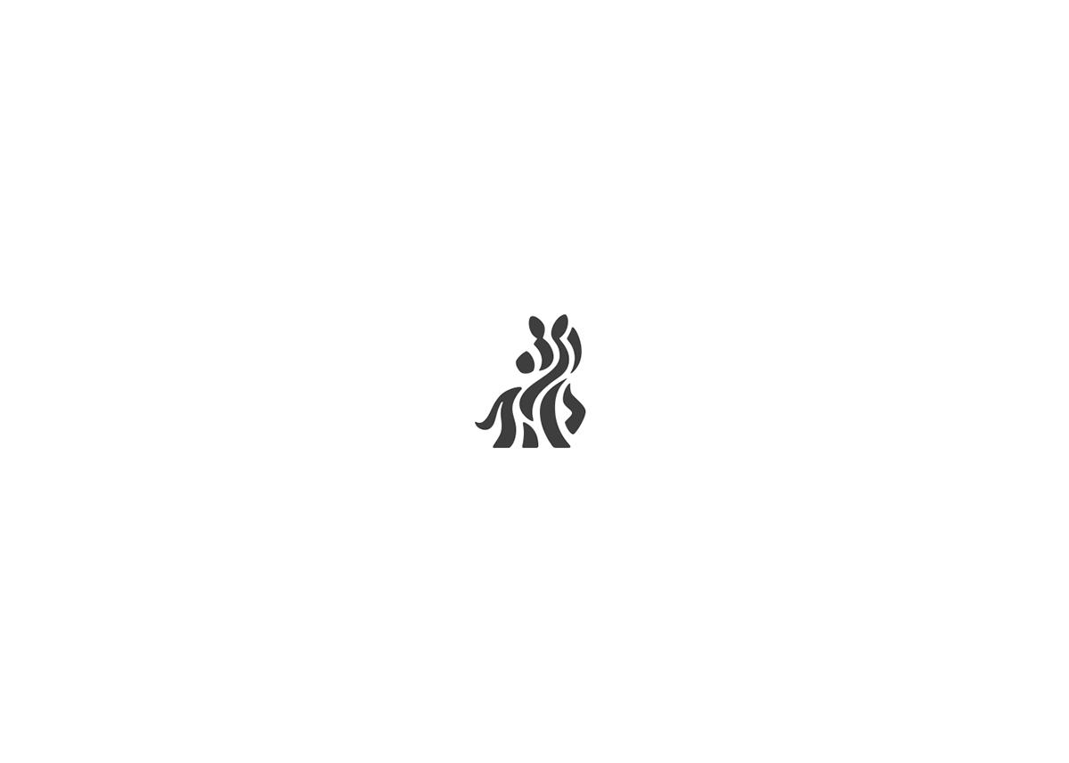 negative logo marks animals creative identity logo designer Kreatank creatank bodea daniel lion Rhino zoo wild negative-space
