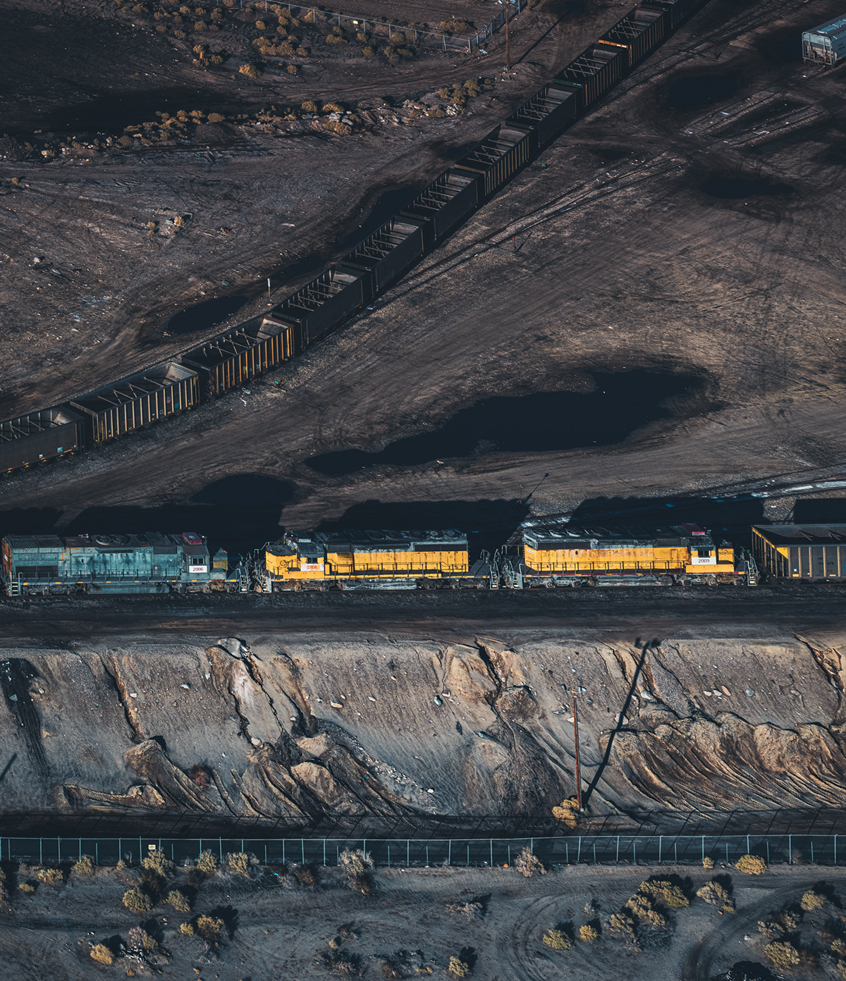 Aerial black gold fine art industrial Mining mitch rouse oil phase one train transportation