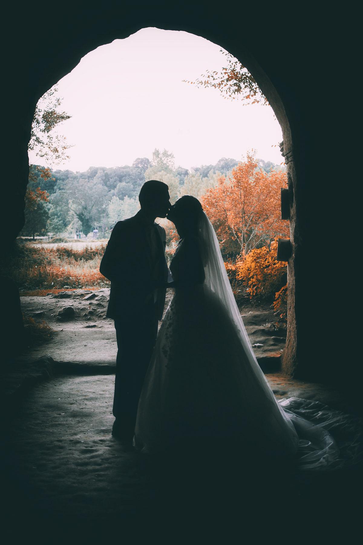 Image may contain: wedding dress, kiss and bride