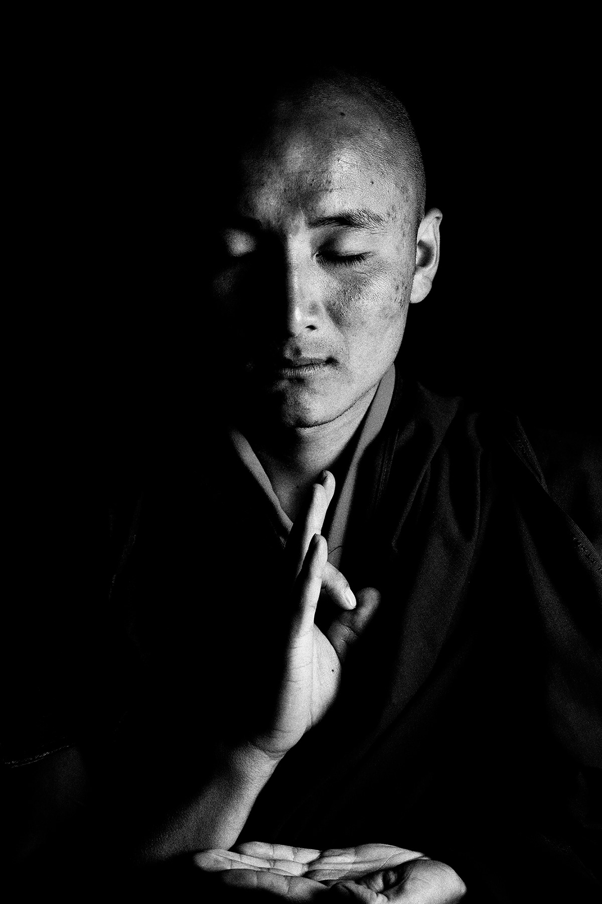Eyes Closed Portrait of a Bhutanese Monk: Black and White Photography by Jean Tran and Élysée Lang
