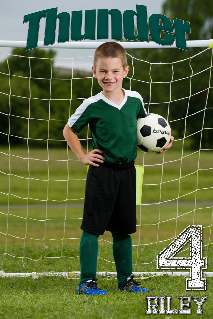 Child soccer player posed
