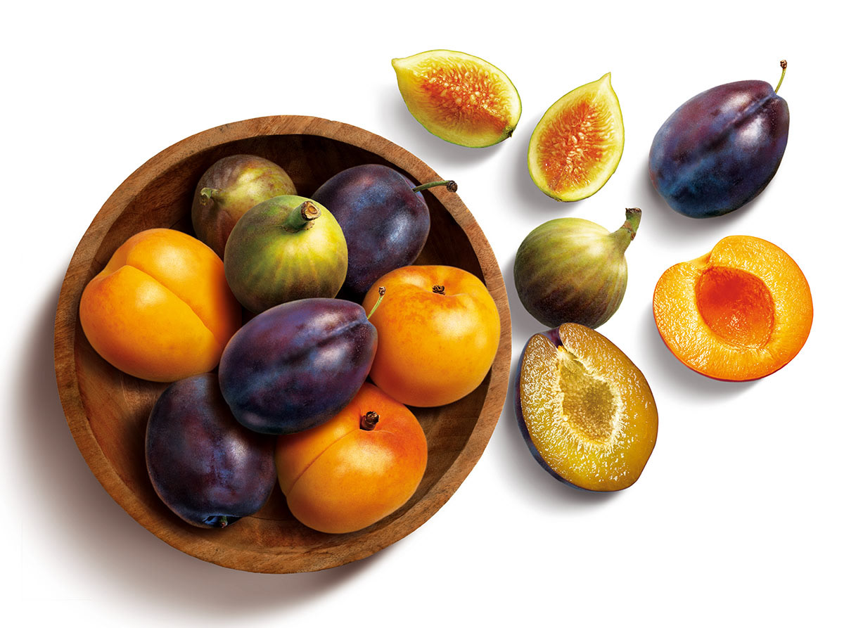 Super realistic photographic illustration of fresh fruit in a bowl for Fibre Blend packaging.