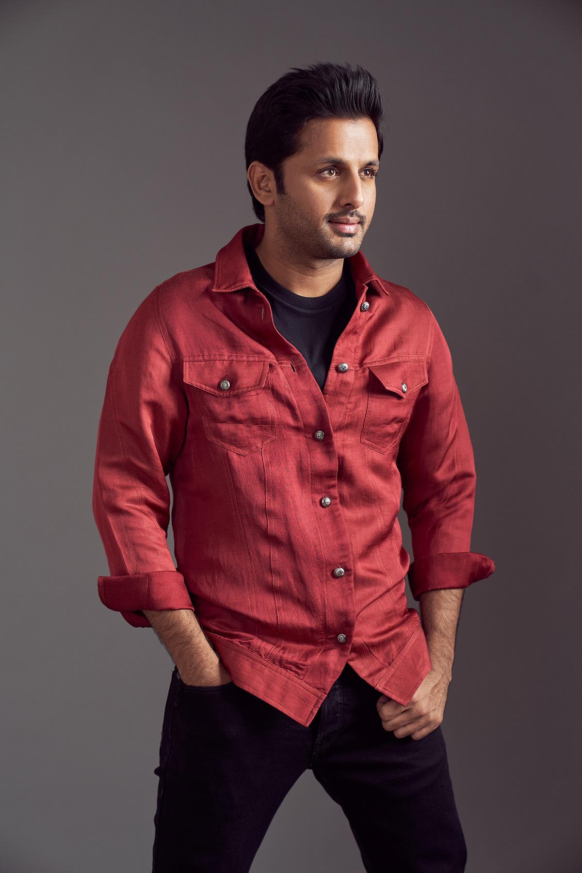 Image may contain: person, shirt and wall