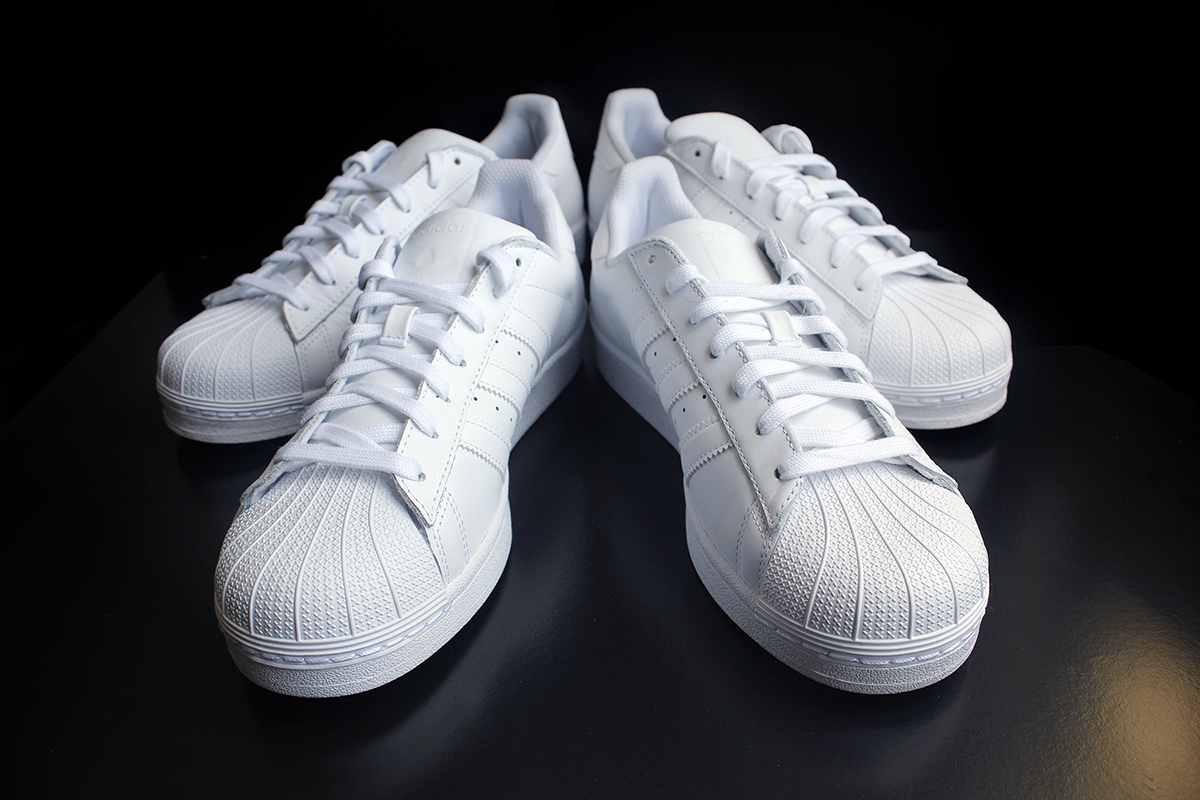 4ca710d90a9c ... sale two pairs of triple white adidas superstar 948cf ff258