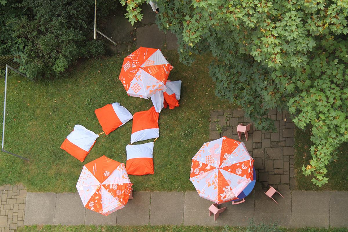 Image may contain: umbrella, tree and grass