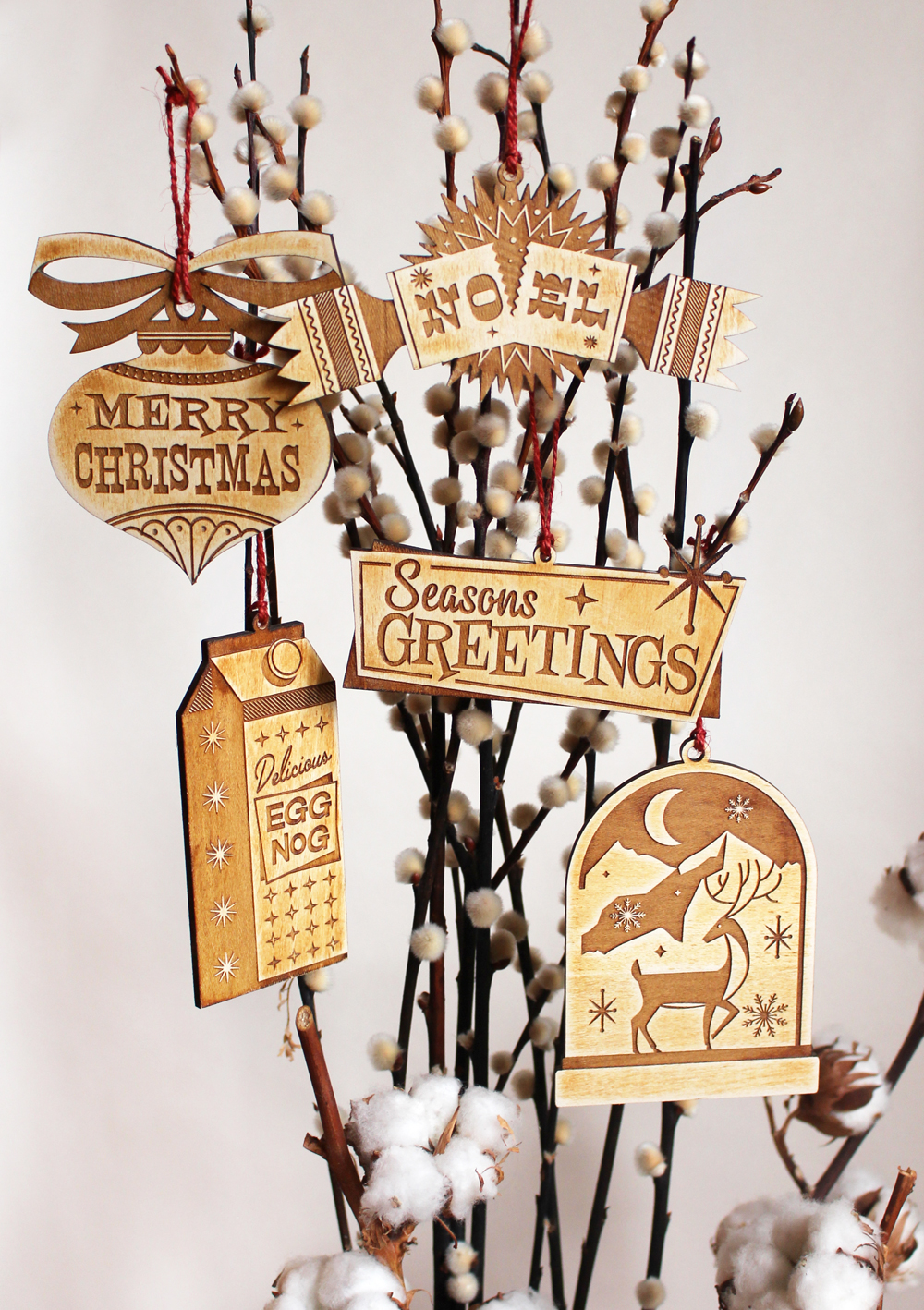 illustrated laser cut wooden christmas tree ornaments on behance
