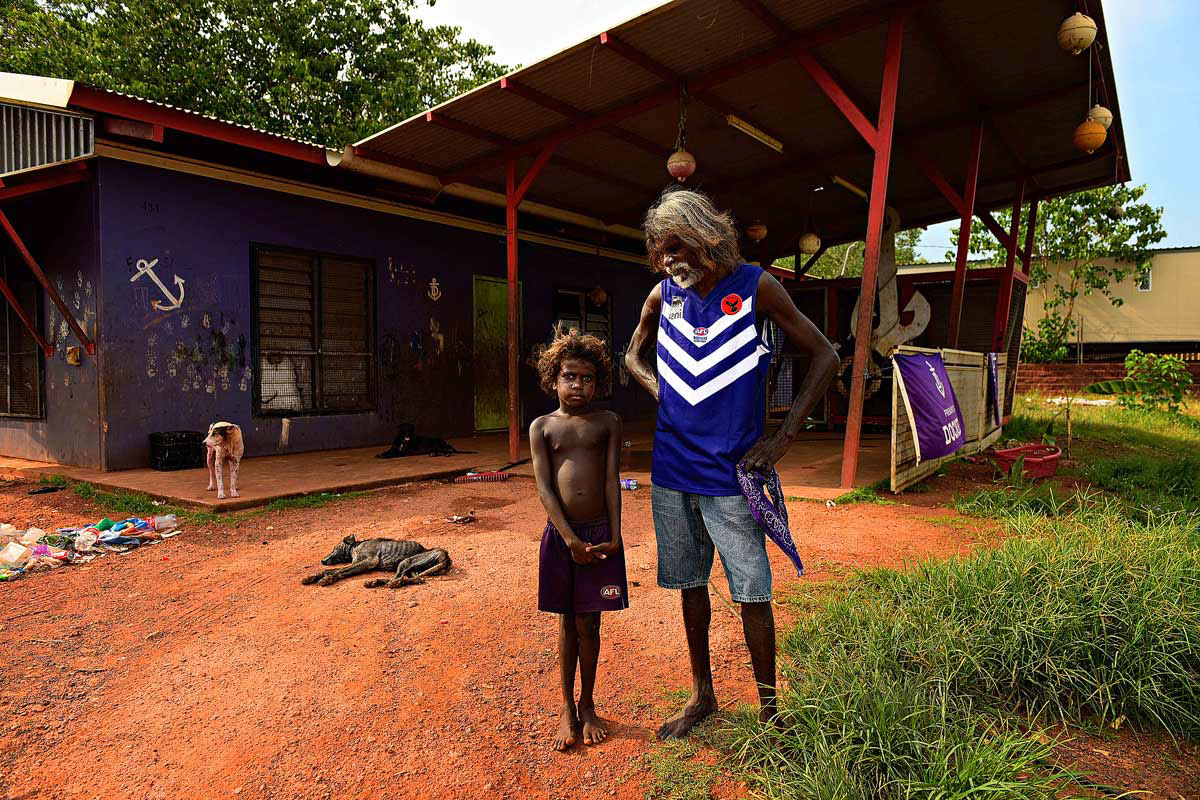 "Wudupulli Nama Dockers coach Adrian ""Wildhorse"" Lantjin with grandson Phillis Lantjin, 7, at the ""Dockers House"" before the Wadeye Football League match in the Northern Territory"