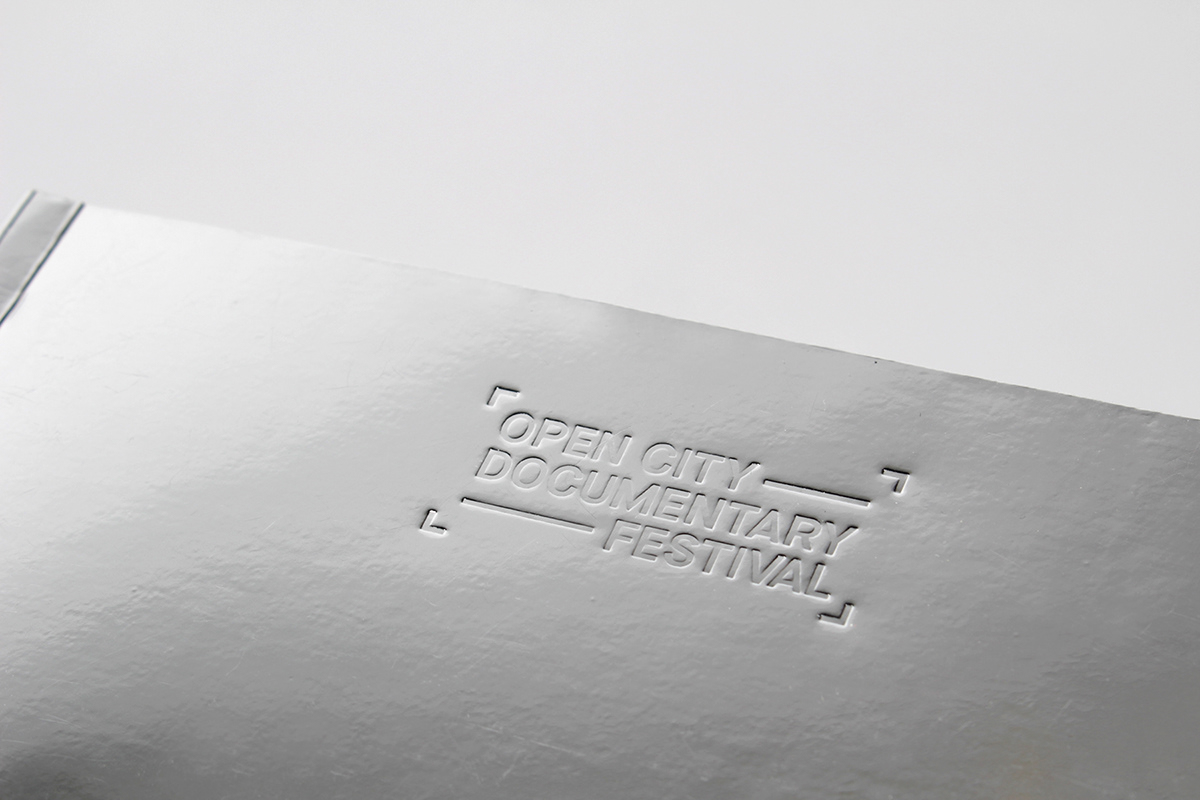 Film   festival Documentary  tickets embossed silver reflective book Layout neon