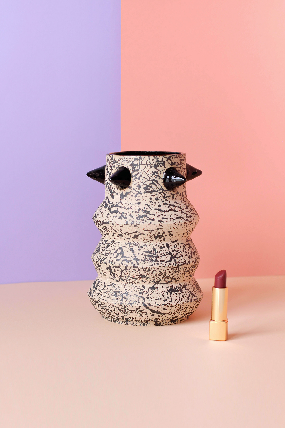 Image may contain: wall, vase and art