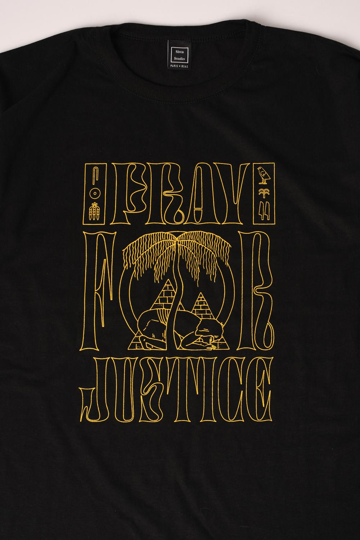 Image may contain: clothing, shirt and black
