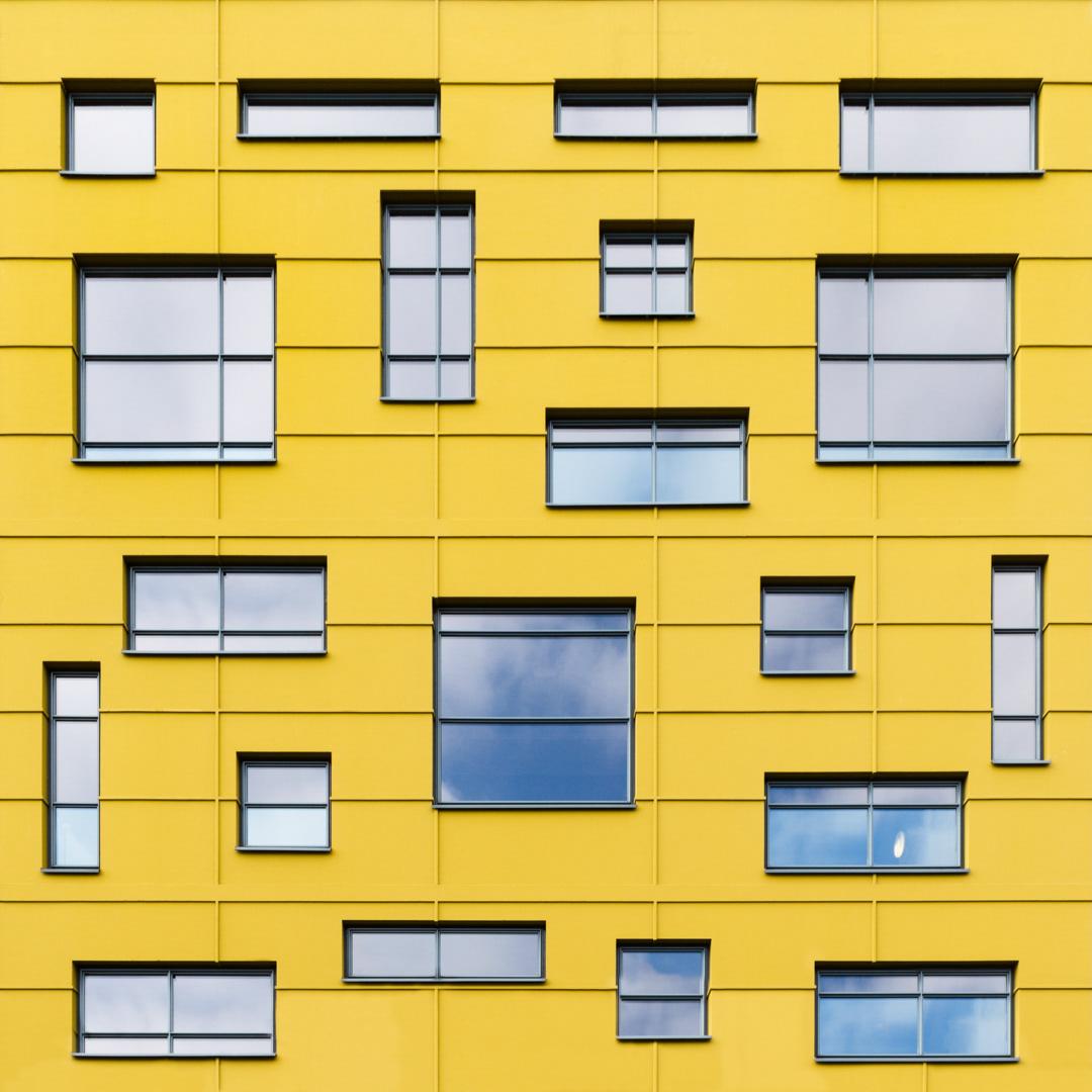 Beautiful yellow facade designed by Dedato ontwerpers in 2006