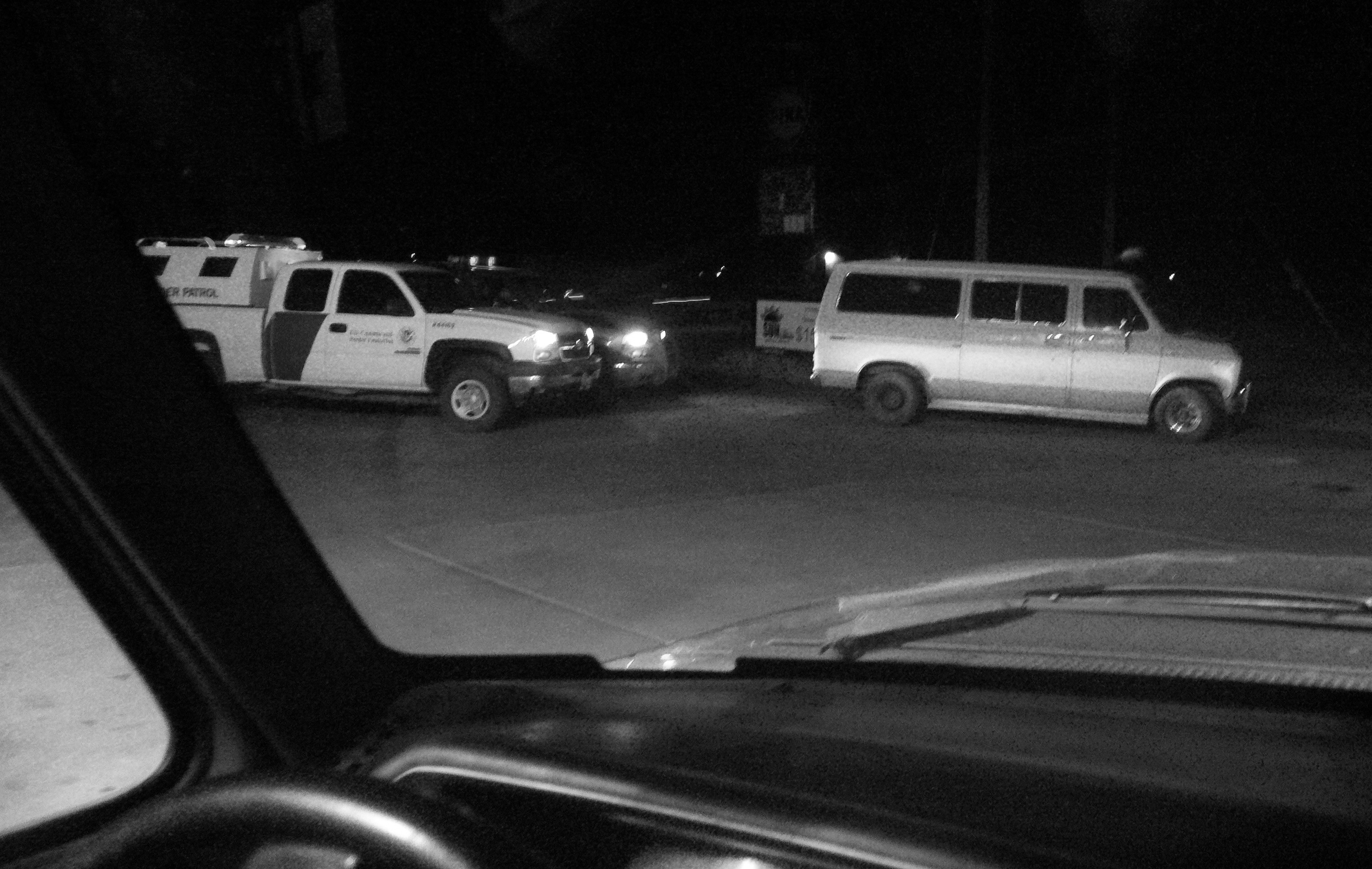 A border patrol vehicle behind a van