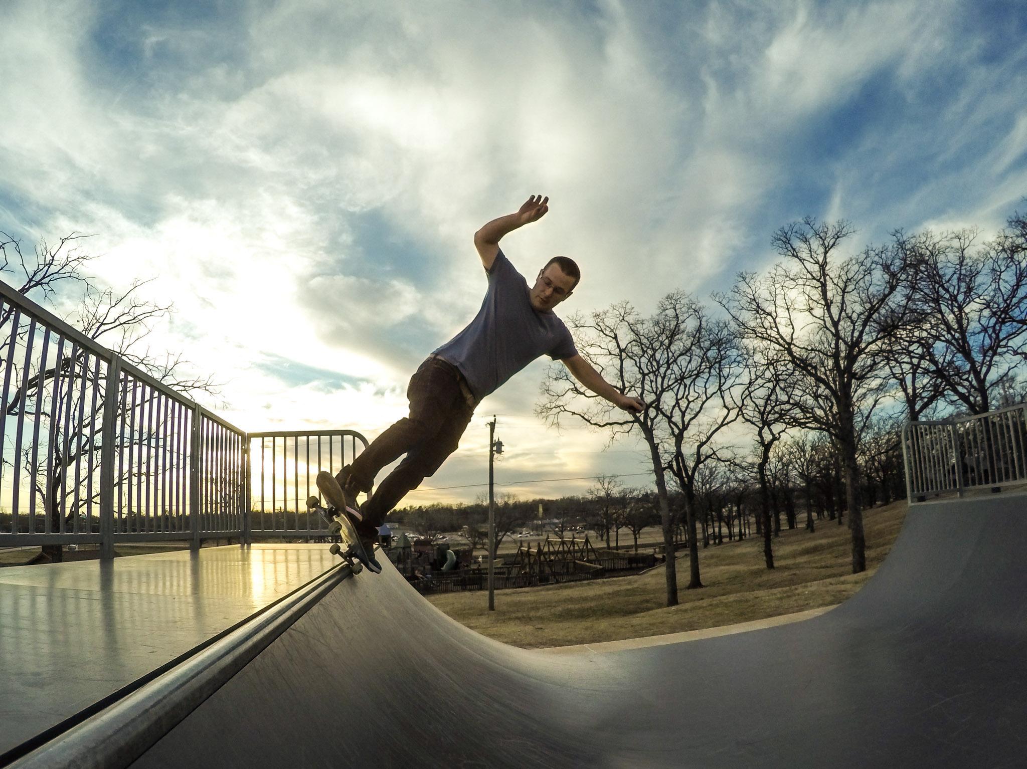 Ryan 5-0 grind skateboarding