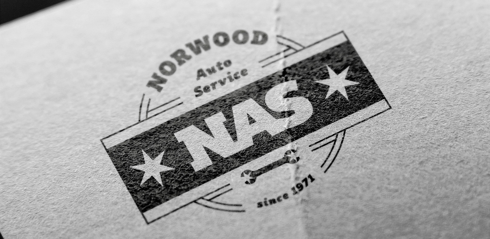 This image shows Norwood Auto Service's (NAS) new logo printed on workout paper. We were asked to create a logo that resonated with the traditional Chicago neighborhood that's home to a lot of old-school Chicagoans.
