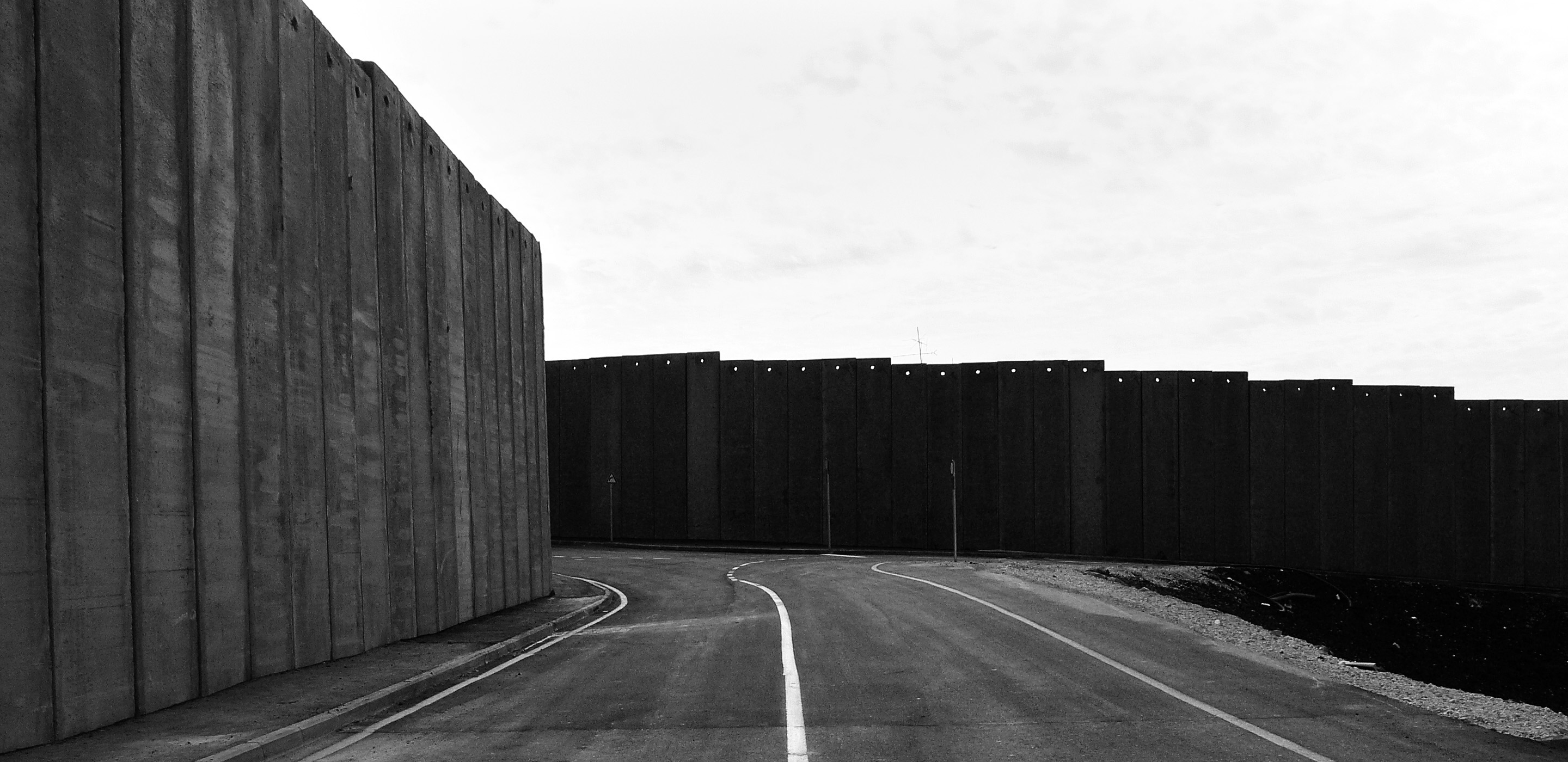High concrete walls enclose a road