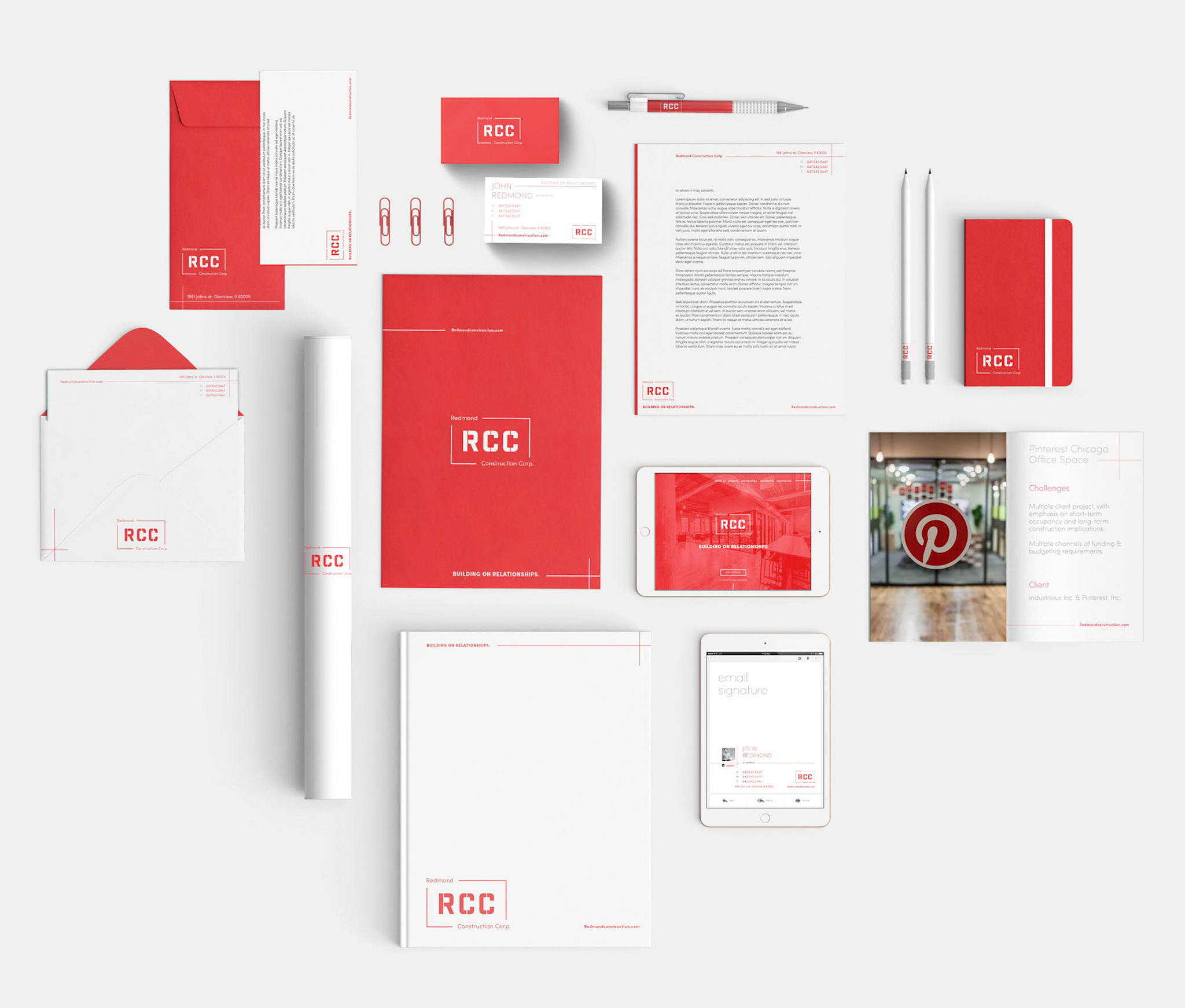 This image shows the branded (predominantly red and white) stationery at a glance. Including: envelopes, letterhead, business cards, blueprint roll, brochure, email signature, and folder.