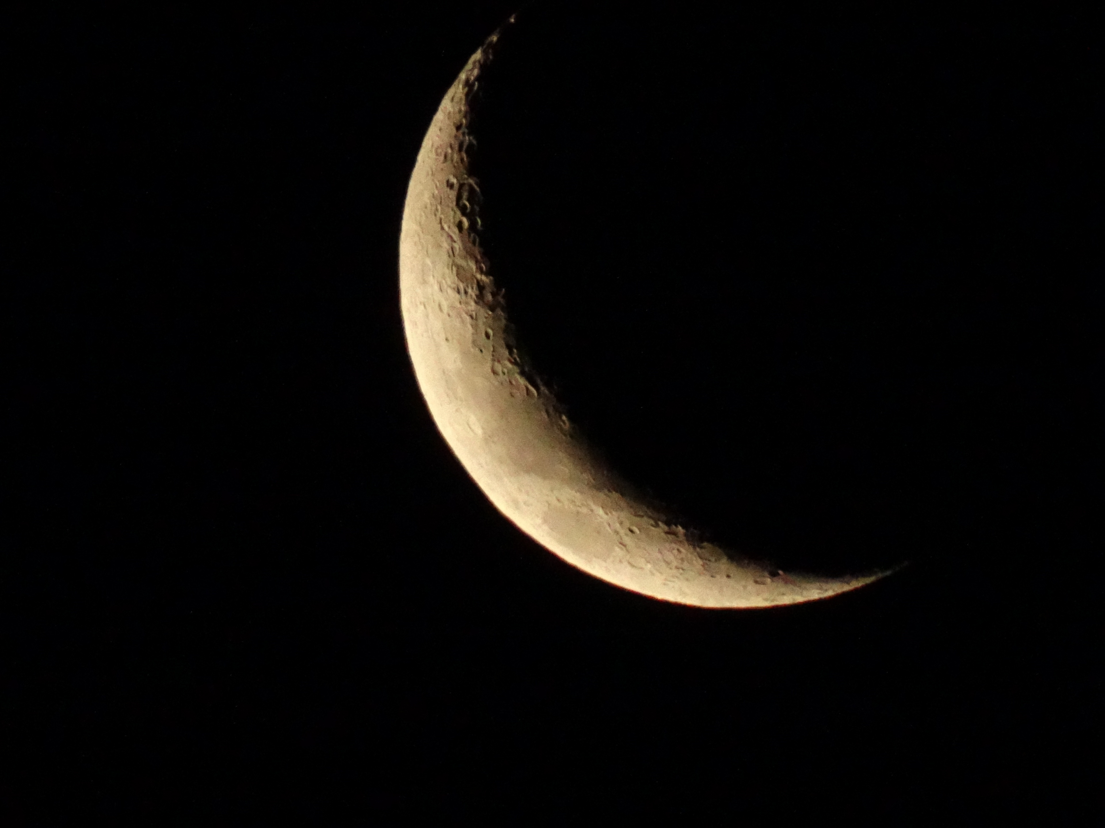 The close up shot of the moon on a clear night - not bad with the city lights