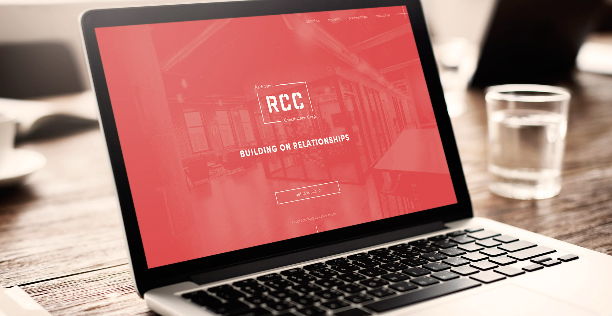 This is a mockup of the Chicago based construction company's (RCC) homepage, on a mac book.