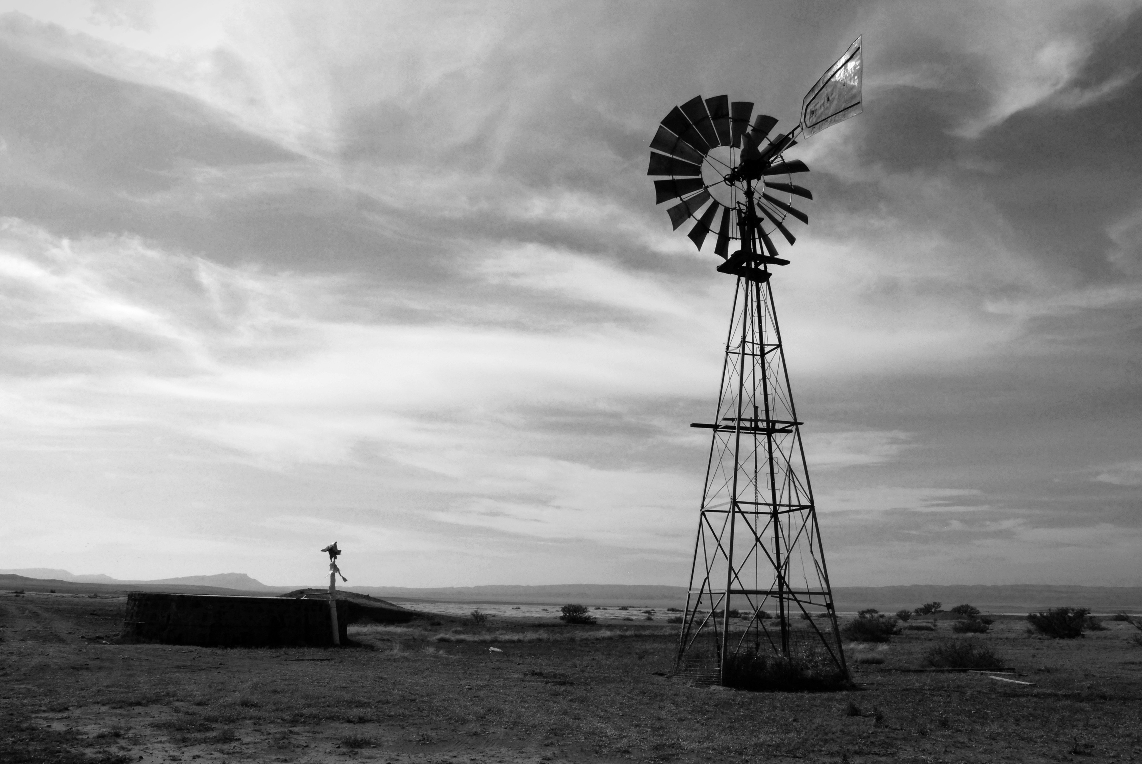 A windmill in a desert landscape