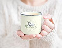 Free Female Holding Tea Cup Mockup