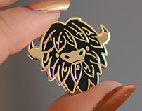 Leafy Yak Face! Black and gold pin.