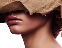 Beauty young female Model with kraft Paper on her Head