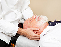 A patient receiving chiropractic treatment