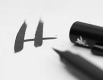 Hyggelaget brushlettering logo
