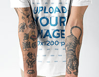 Closeup of Tattoos in a Mans Arms While Wearing a Round
