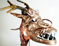Masks- white stag and copper dragon.