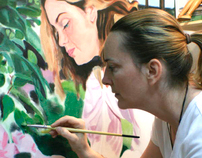 Roxanne Poliquin painting in her studio.