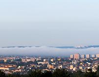 MLHA SE VALI MESTEM /FOG ROLLING OF A CITY; BRNO