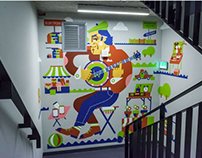 Murals painted on a stairwell in Deloitte'