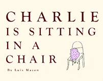 Charlie is sitting in a chair