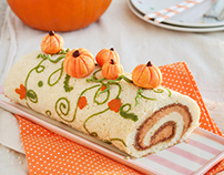 Sponge roll with pumpking creme mousseline and walnut p