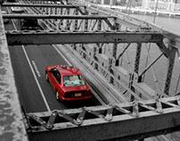 Car crossing Brooklyn Bridge