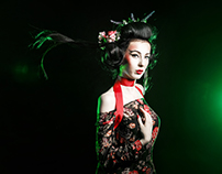 Geisha with the hairstyle and makeup in a kimono.