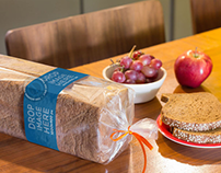Mockup of a Packaged Loaf of Bread on Top of a Table