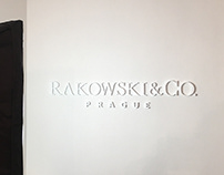 3D logo RAKOWSKI & CO. on wall in office