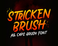 FREE | Stricken Brush all caps brush font