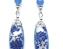 Earrings with painted shell