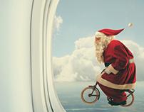 Santa rides a bike