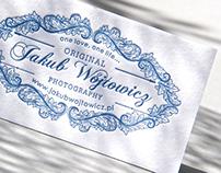Blue ornamental letterpress business card.
