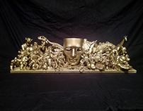 Gold mask sculpture